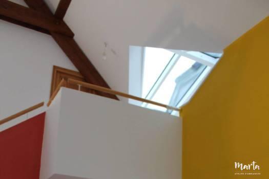 4. Nouvelles couleurs ; jaune et rouge brique, structurant l'espace séjour et apportant l'ambiance ethnique
